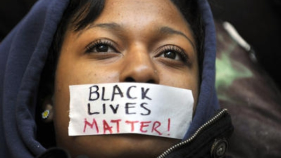 Black-Lives-Matter-taped-over-young-Black-womans-mouth
