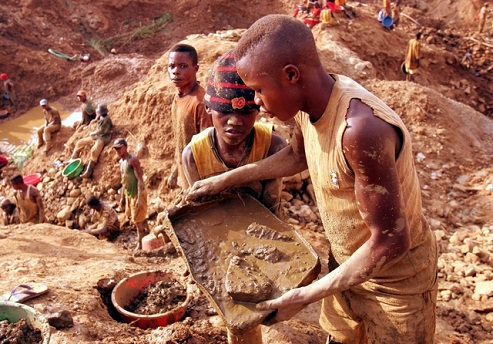 Congolese miners dig at a gold mine in Montgbawalu